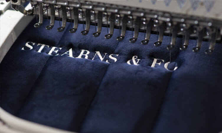 Embroidered Sterns & Foster Logo being sewed on a mattress.